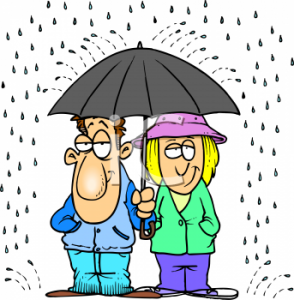 461_happy_couple_standing_under_an_umbrella_together_in_the_rain