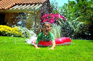 picniked. Boy Splashing on grass