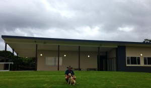 Tony and Keith the dog at Casuarina Hockey club after they installed the new green hill